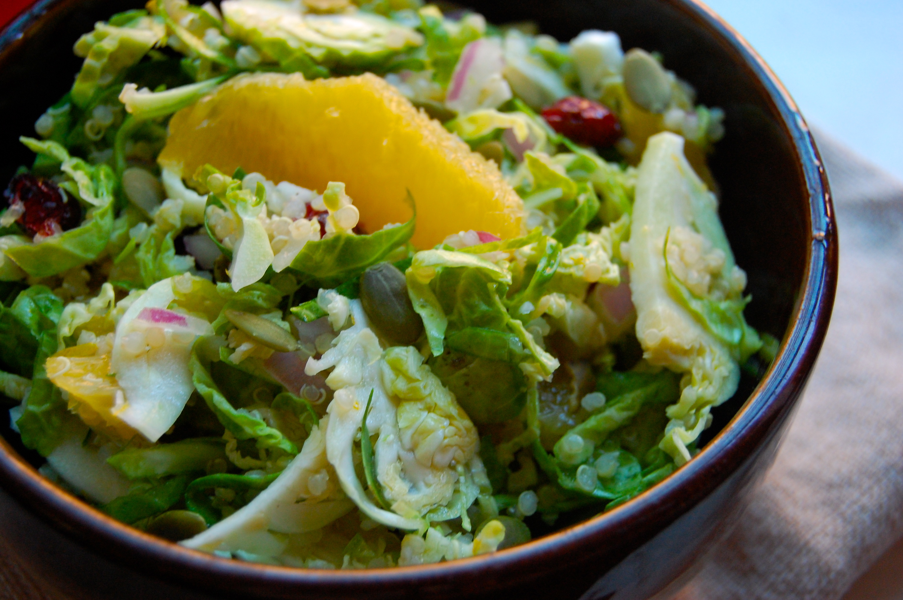 Shaved Brussel Sprout and Quinoa Salad with Cranberries and Oranges