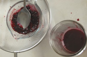 Straining Blackberry Honey Syrup
