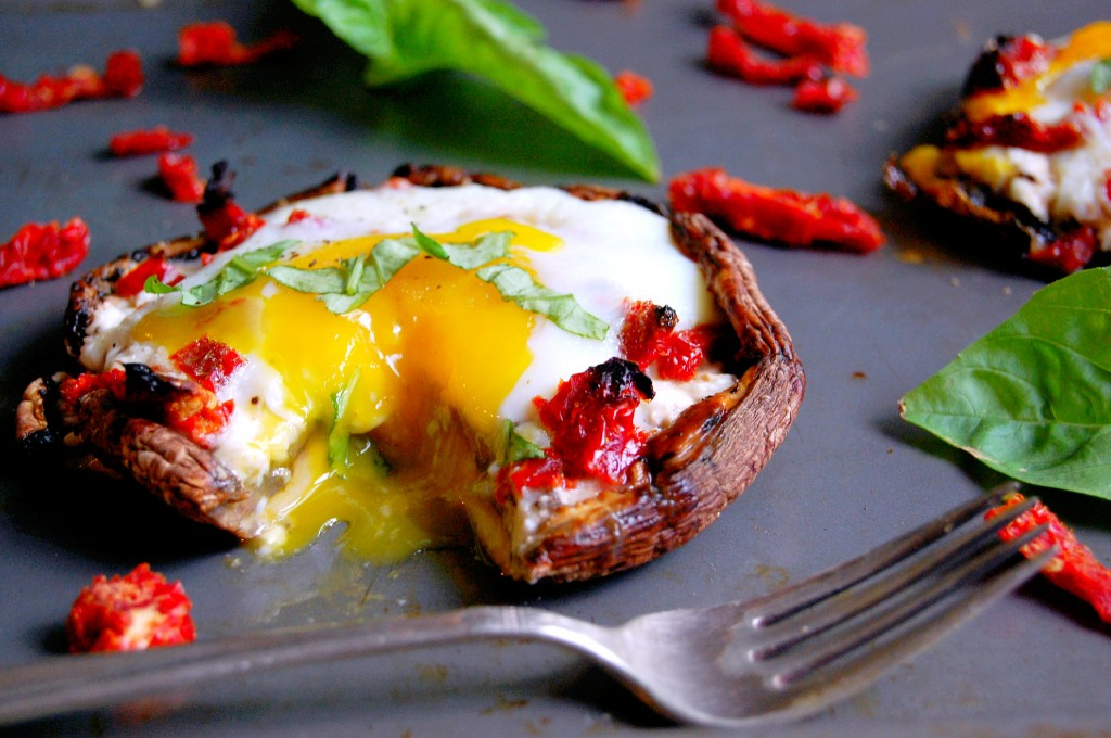 Portobello Baked Eggs filled with goat cheese and sundried tomatoes