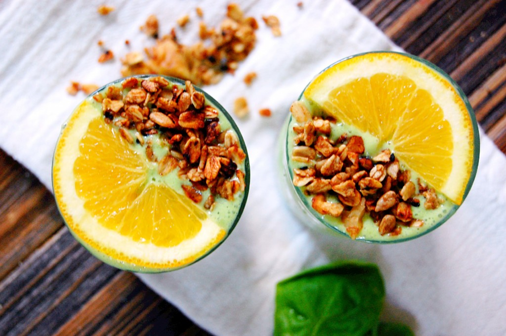 A Bright and Sunny Green Orange Julius topped with granola for a healthy breakfast treat