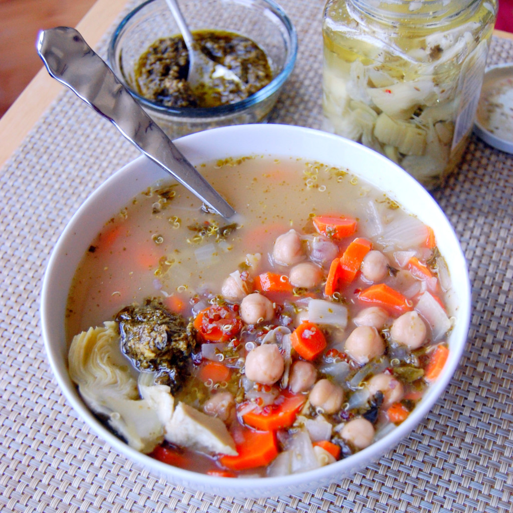 Mediterranean Quinoa + Chickpea Soup topped with pesto and marinated artichokes | Uproot from Oregon