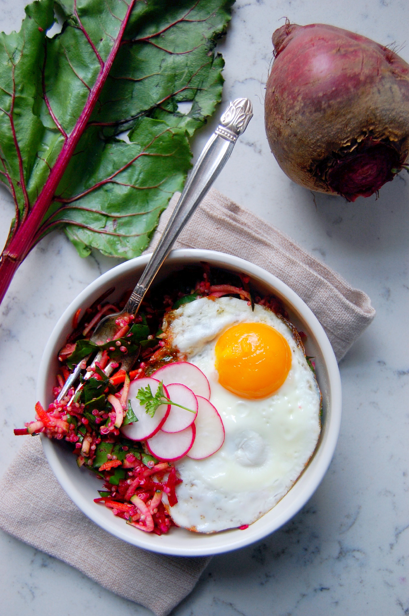 Bright Beet Quinoa Salad with Lemon and Ginger, topped with a fresh fried egg and radishes   uprootkitchen.com