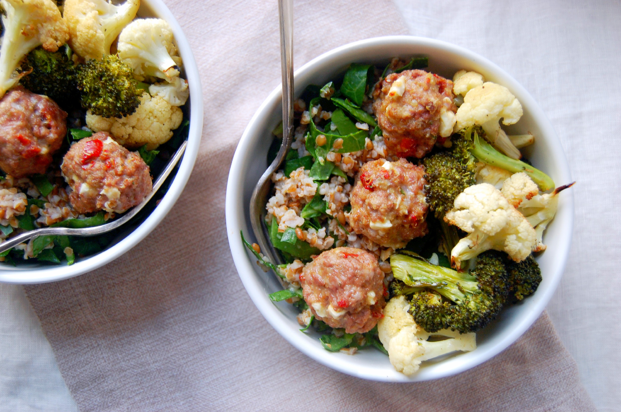 Bulgur wheat is a great base for a roasted vegetable and lamb meatball bowl - a healthy recipe for a fun meal! | uprootkitchen.com