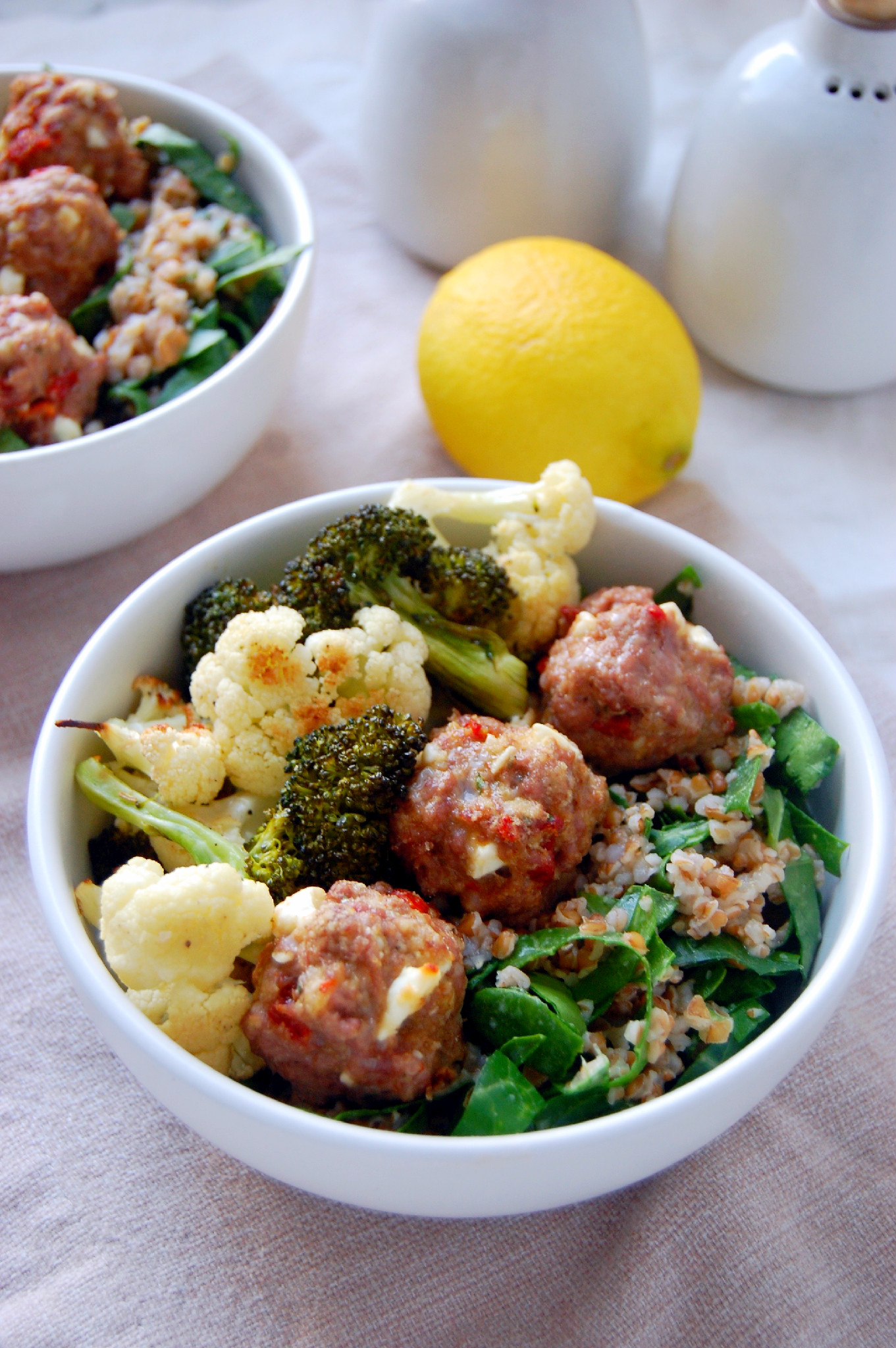 Lemon Bulgur Wheat with Collard Greens, Lamb Meatballs with Feta and Sundried Tomatoes, and Roasted Vegetables - all layered in a bowl for a perfect spring dinner | uprootkitchen.com