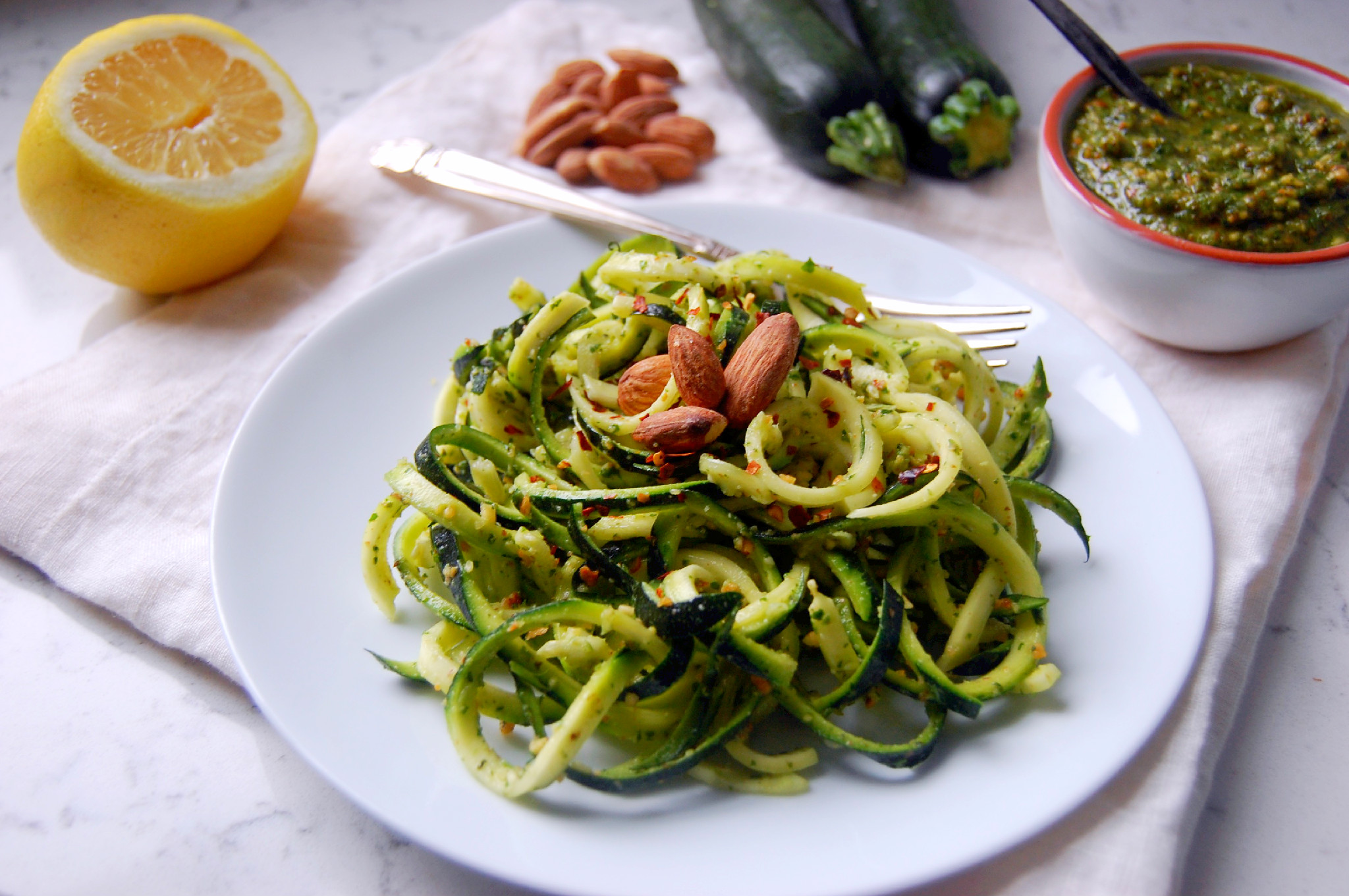 Quick and Easy Zucchini Noodles with a Dairy-free Chunky Almond Pesto | uprootkitchen.com