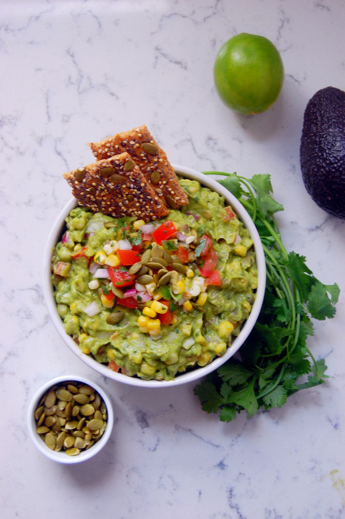 If you love corn salsa, you're going to love this Chunky Sweet Corn Guacamole with Pepitas! The pumpkin seeds add a bit of crunch to the guacamole recipe #glutenfree #vegan | uprootfromoregon.com