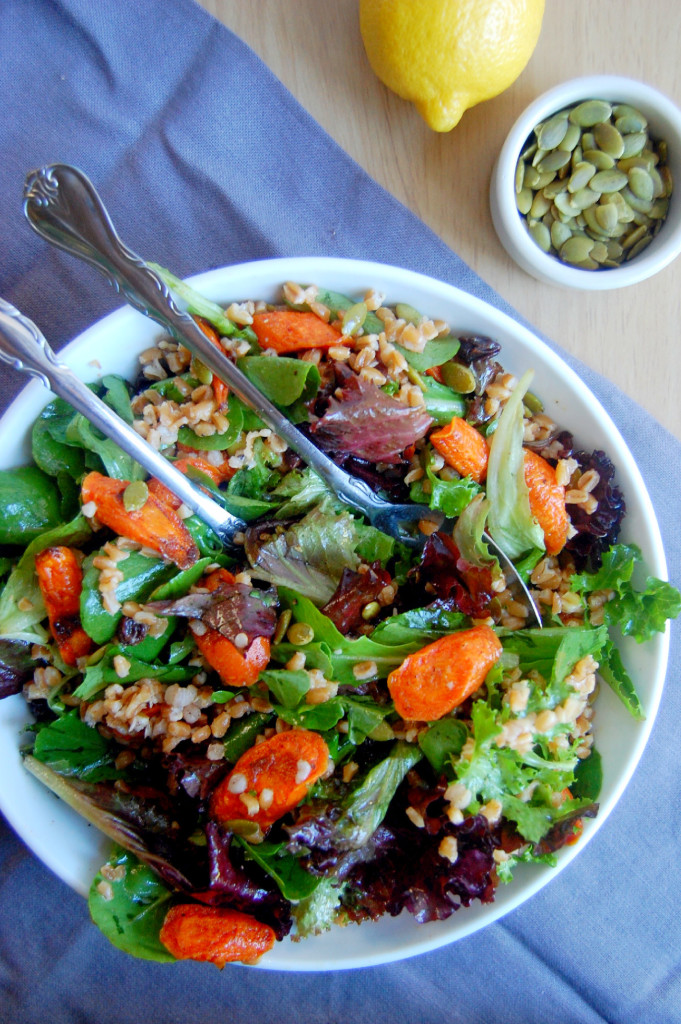 Cinnamon Roasted Carrot and Farro Salad, topped with raisins and pumpkin seeds. The perfect fall vegetarian dish! | uprootfromoregon.com