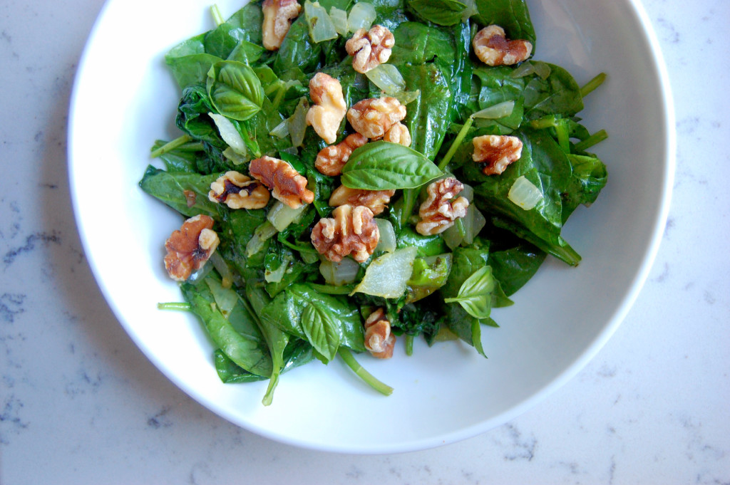 Garlic and Basil Wilted Spinach with Toasted Walnuts - a simple side dish that takes just a few minutes in a saute pan #glutenfree #paleo #vegan | uprootfromoregon.com