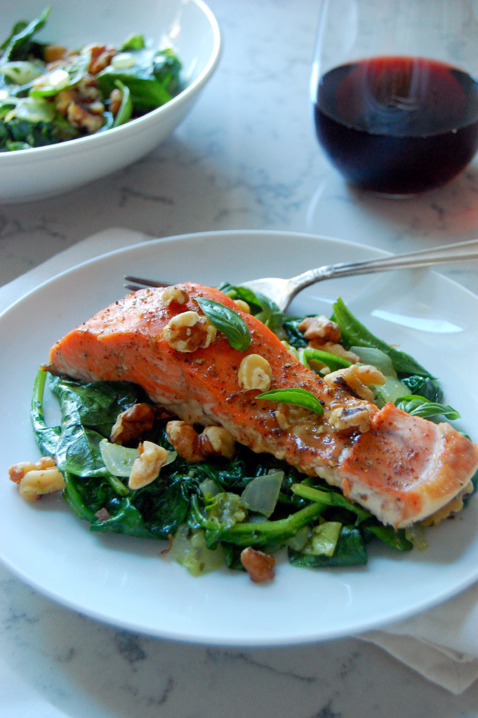 The perfect piece of salmon glazed with dijon and maple syrup, served on garlic and basil infused wilted spinach and toasted walnuts! The best part? 30 minutes start to finish for a beautiful dinner! | uprootfromoregon.com.jpg