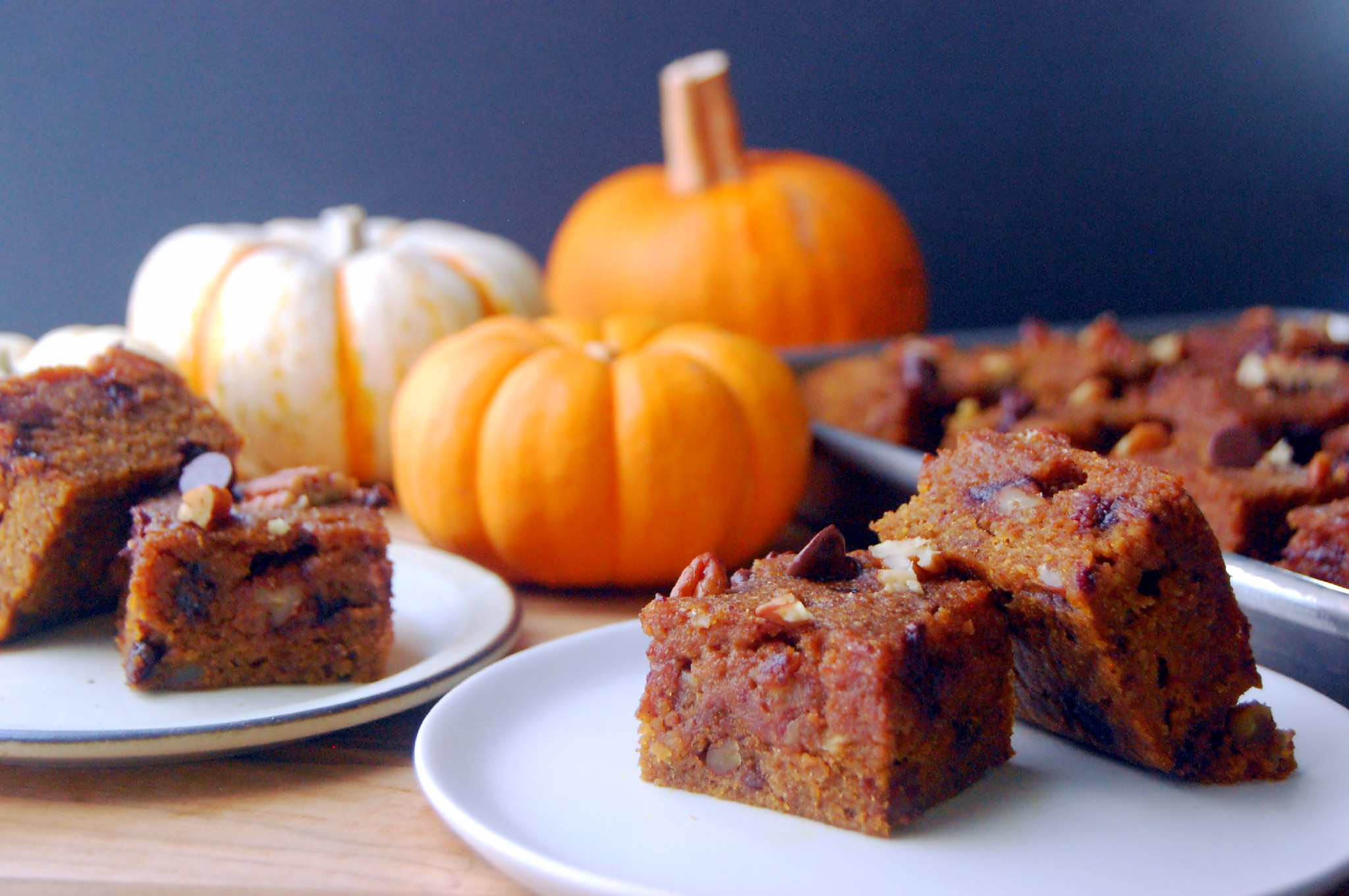 Moist and fudgy Pumpkin Blondies with Pecans and Chocolate Chips, made with whole wheat flour and maple syrup. They're a wholesome fall treat! | uprootfromoregon.com