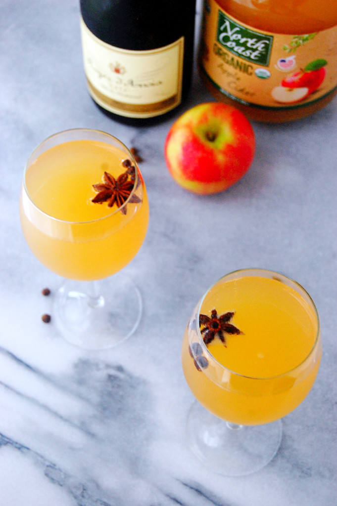 Spiced Apple Cider Mimosas - the perfect simple champagne cocktail to whip up while you're prepping holiday foods with friends. | uprootfromoregon.com