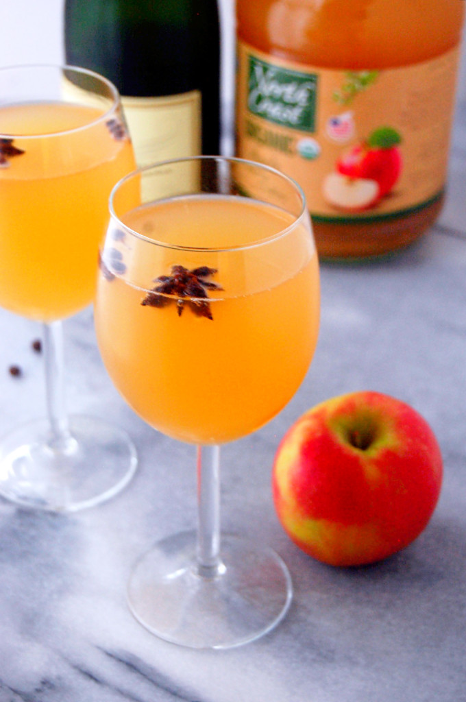 Spiced Apple Cider Mimosas with star anise pods and allspice berries, a simple way to make a quick winter cocktail more festive! | uprootfromoregon.com