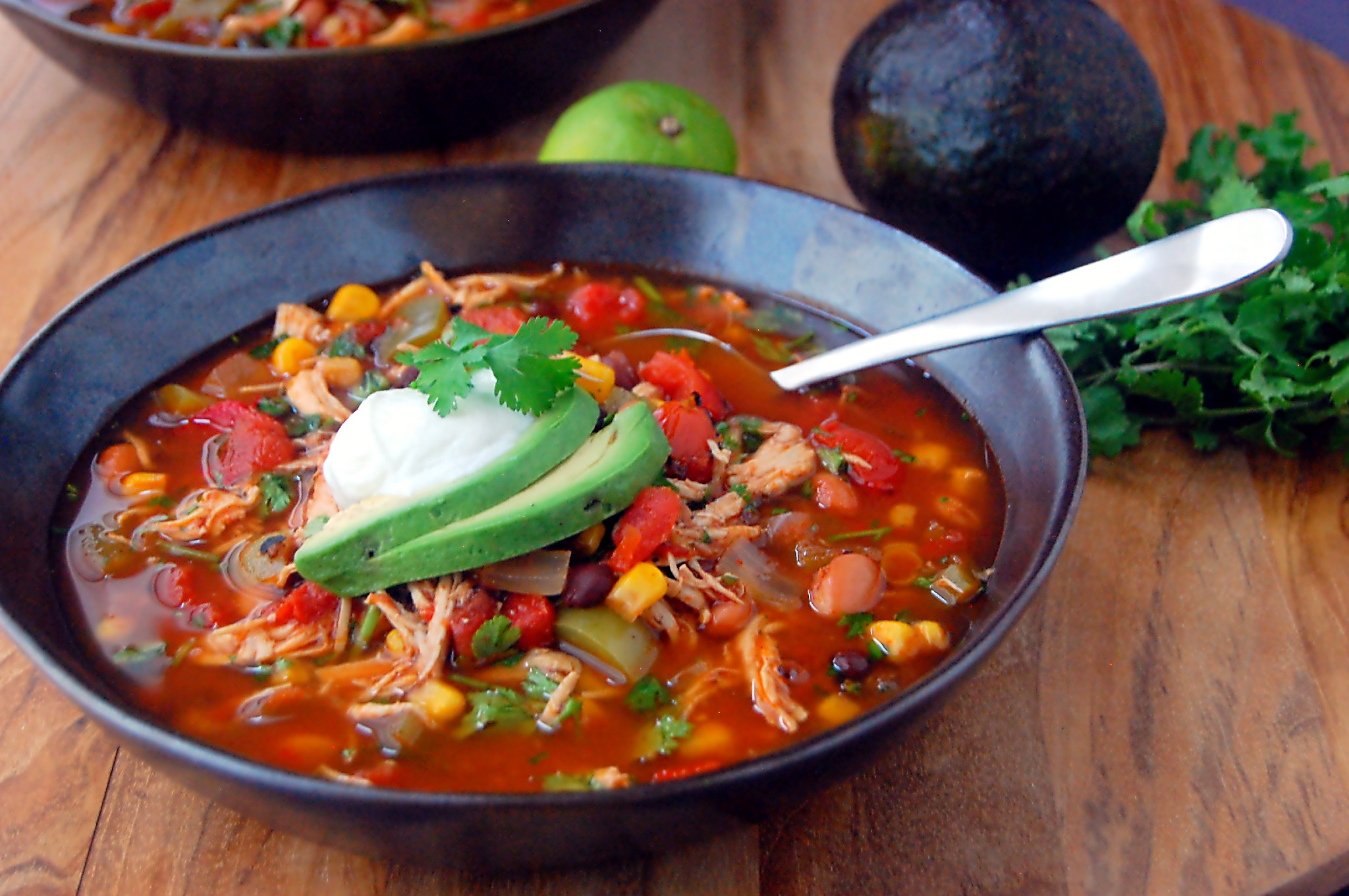 A simple recipe for Slow Cooker Southwestern Chicken Soup, packed with shredded chicken, beans, tomato, corn, and simple spices.