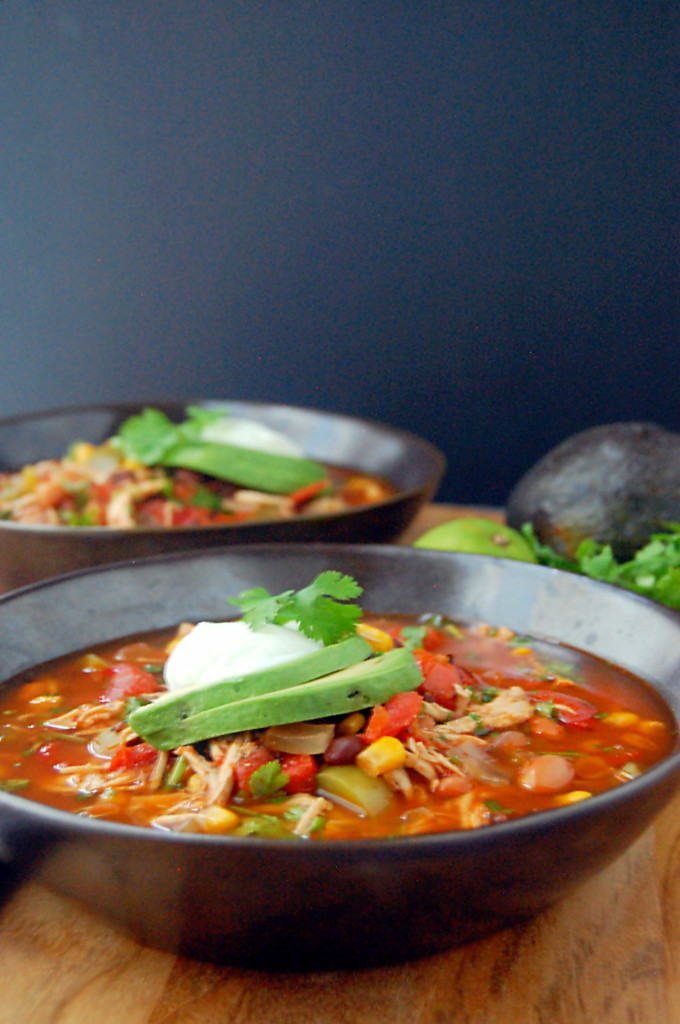Soup is packed with shredded chicken, diced vegetables, beans, corn ...
