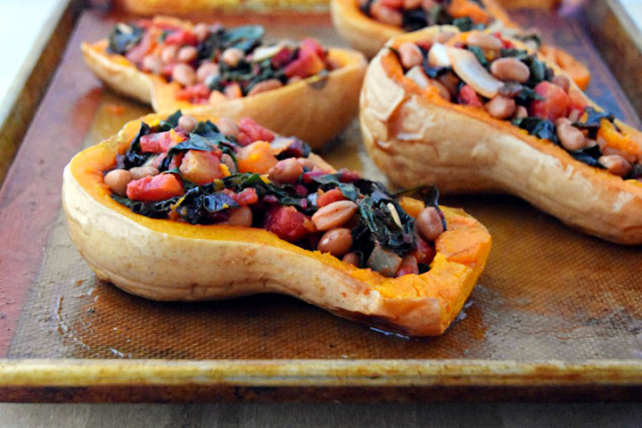 A simple vegan recipe for Mexican Stuffed Butternut Squash, packed with pinto beans, Swiss chard, and diced tomatoes. | uprootkitchen.com