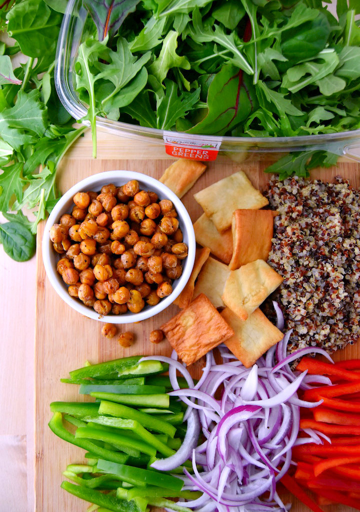 Mediterranean salad ingredients with crispy garlic chickpeas | uprootkitchen.com