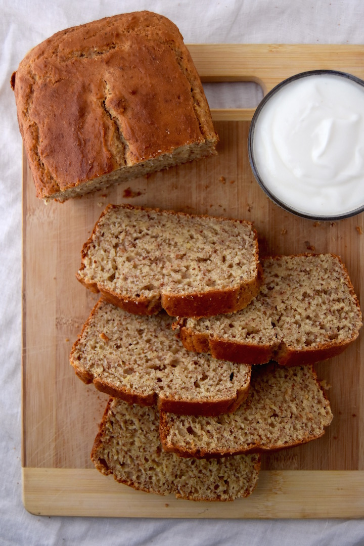 This Whole Wheat Yogurt Quick Bread is a 7 ingredient, one-bowl loaf you can throw together quickly for the week. Packed with lemon zest for spring flavor! | uprootkitchen.com