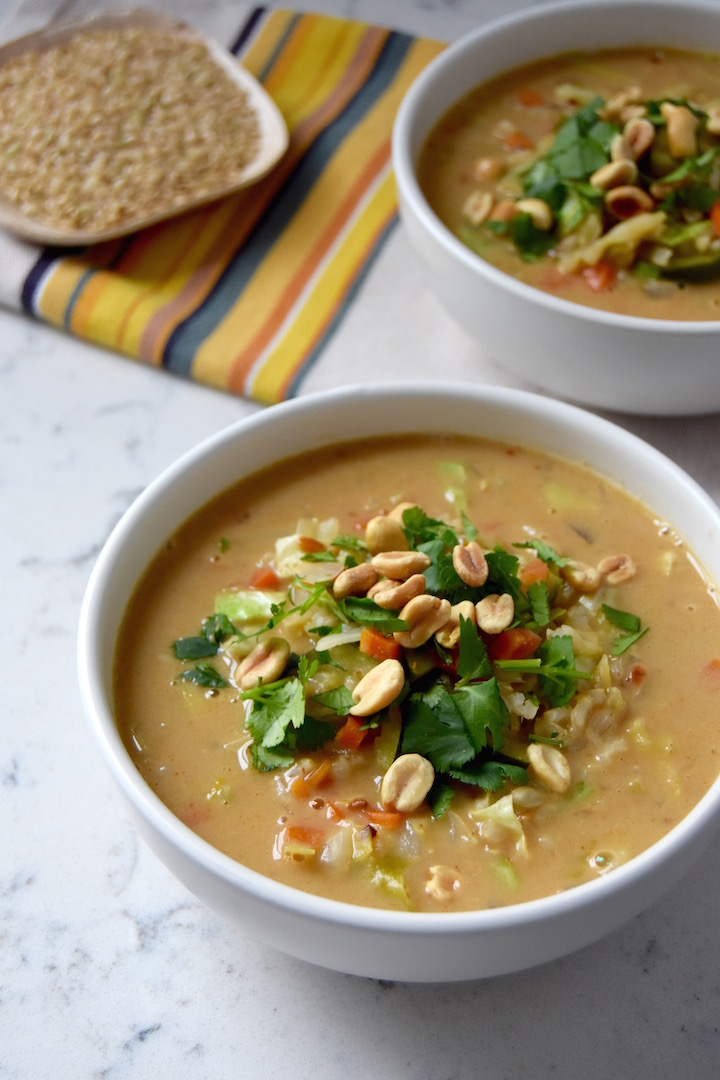 This African Peanut and Vegetable Soup is made by combining a rich vegetable broth with a variety of veggies, filling brown rice, an peanut butter. | uprootkitchen.com