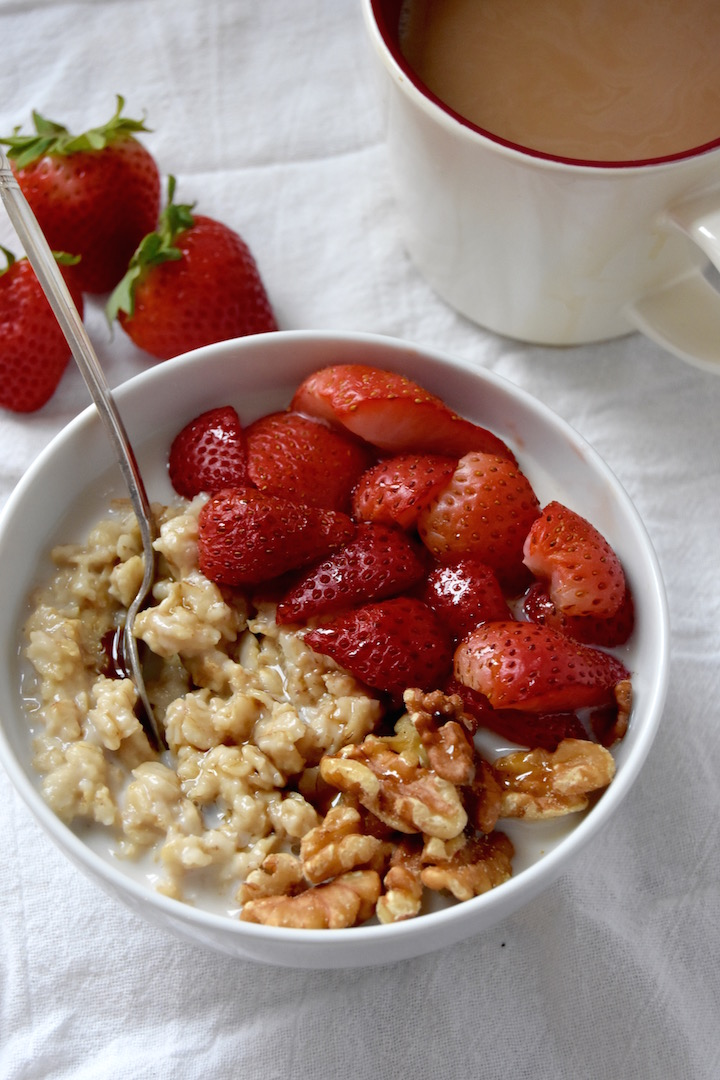 You'll love this tasty bowl of Maple Vanilla Oatmeal with Roasted Strawberries, a delicious take on a breakfast staple. | uprootkitchen.com