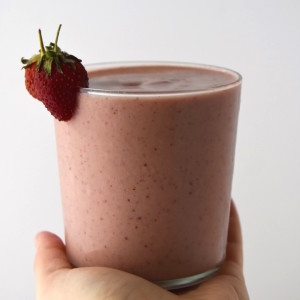 A recipe for a Mango Strawberry Smoothie, using seasonal fruit, almond milk, almond butter and honey. | uprootkitchen.com
