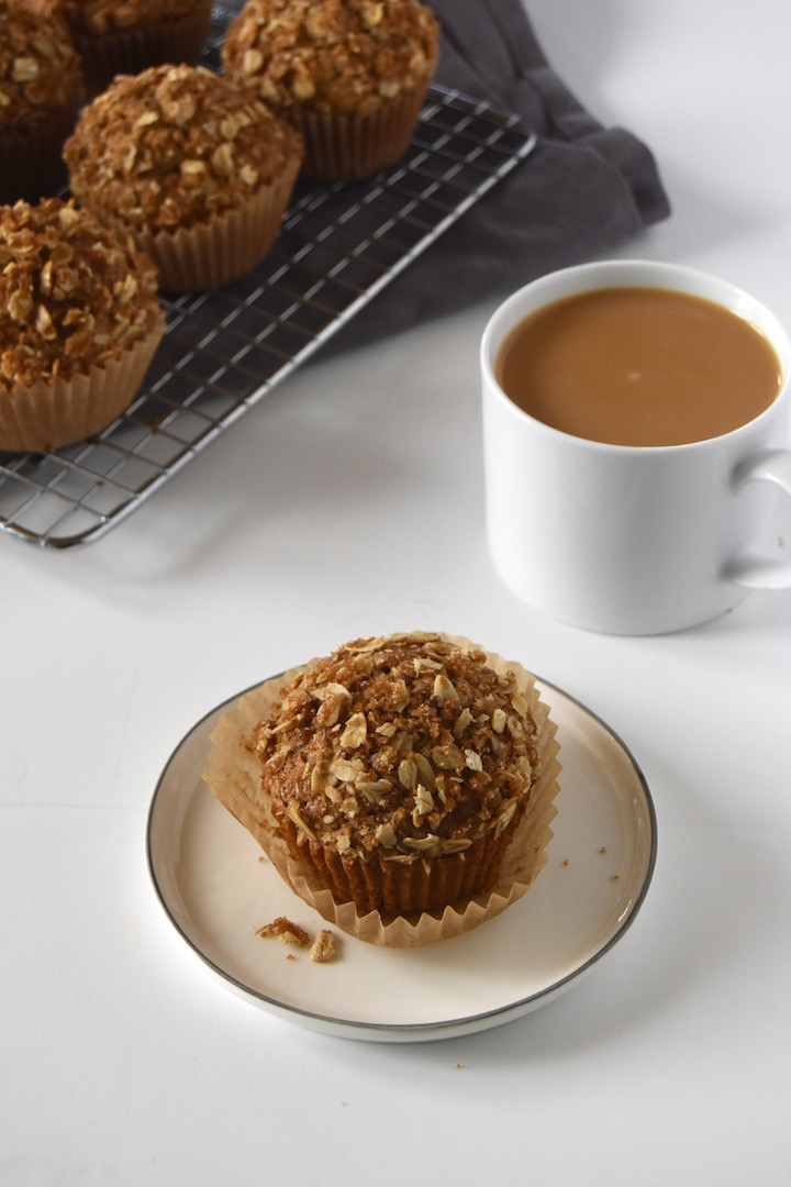 These Wholesome Oatmeal Coffee Cake Muffins are a whole wheat delight, with a soft crumb and sweet oat topping. Bake them up for a brunch with friends or family! | uprootkitchen.com
