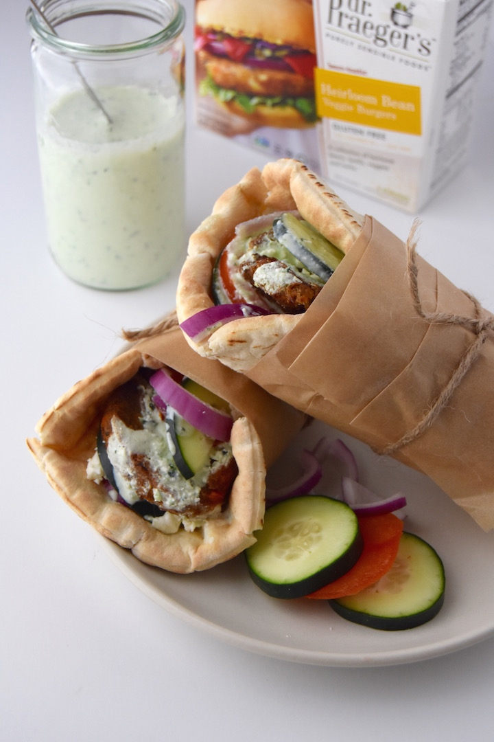 This Greek Veggie Pita Sandwich with Parsley Tzatziki is the perfect way to dress up a veggie bean burger into a meal. | uprootkitchen.com