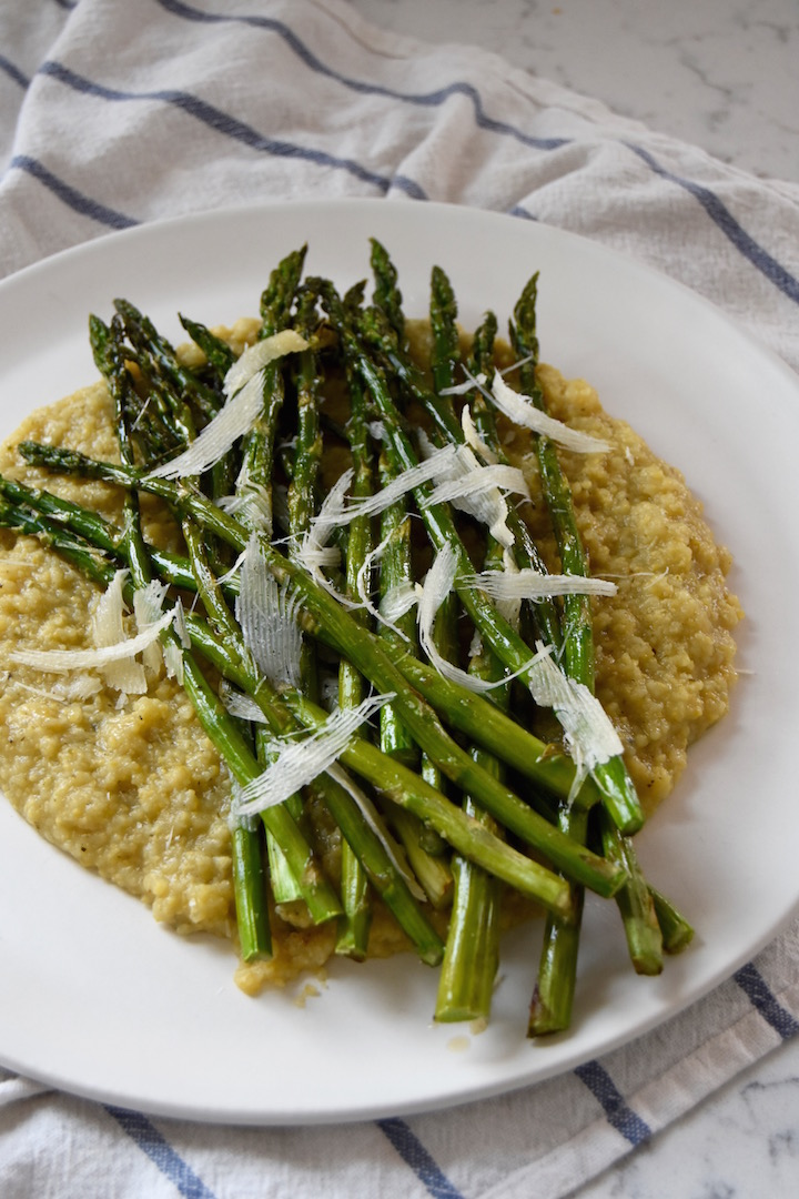 This simple dish of Roasted Asparagus with Parmesan is a great way to highlight spring flavors, served as a side or over polenta as a meal. | uprootkitchen.com