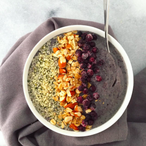 Wild Blueberry Green Smoothie Bowl topped with Granola | uprootkitchen.com