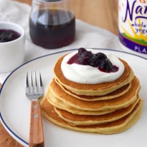 Whole Wheat Yogurt Pancakes with Blueberry Sauce   uprootkitchen.com