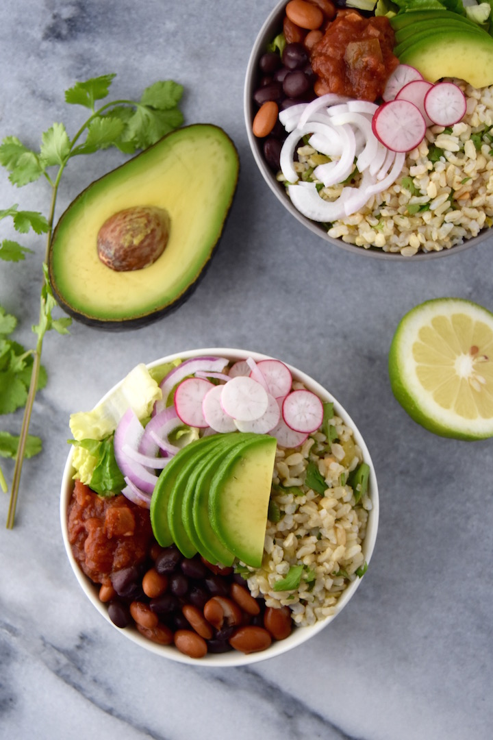 With chewy brown rice flavored with green chiles, beans, crunchy romaine lettuce and all the toppings, you'll look forward to enjoying these Green Chile Bean and Rice Bowls. | uprootkitchen.com