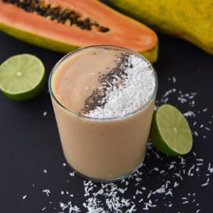 This Tropical Papaya Smoothie is a fresh summer sipper that will cool you down with the flavors of papaya, coconut, banana and lime. | uprootkitchen.com