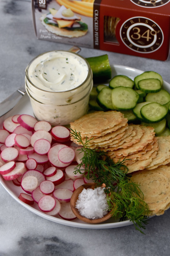 A simple pairing of whipped dill cream cheese, summer veggies and flaky salt on crisps for summer entertaining | uprootkitchen.com
