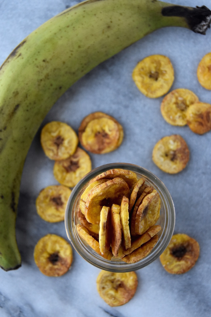 Bake up a batch of these Baked Plantain Chips for midday snacks or for a side for taco night with guacamole. | uprootkitchen.com