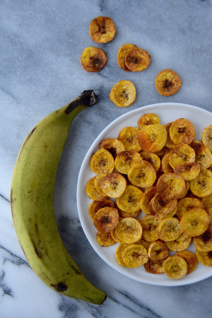 Bake up a batch of these Baked Plantain Chips for midday snacks or for a side for taco night. | uprootkitchen.com