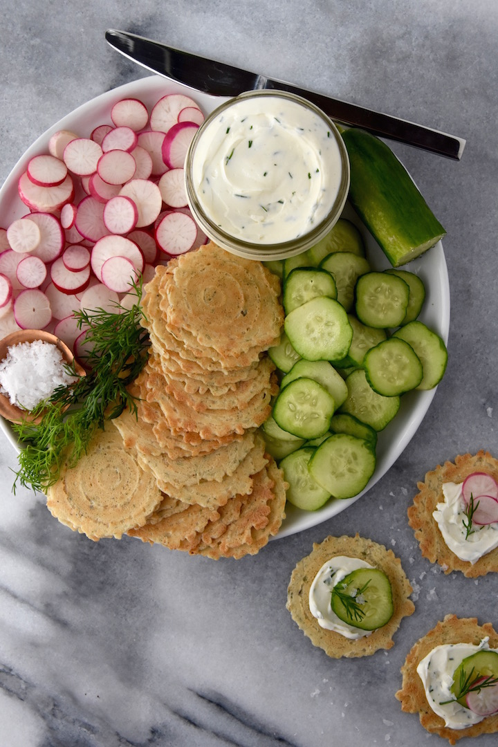 This simple combination of whipped dill cream cheese, crisps, fresh summer vegetables and flaky salt is a wonderful snack plate idea for summer get-togethers. | uprootkitchen.com