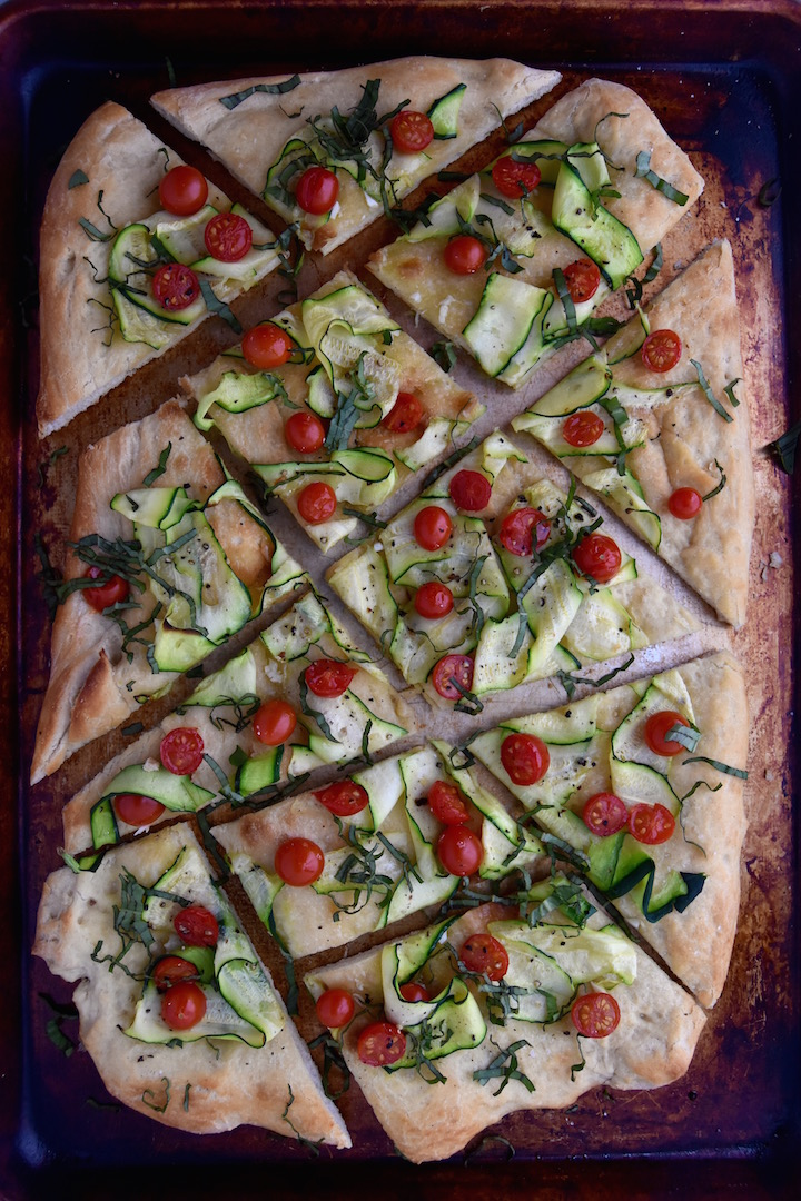 A delicious and simple Summer Flatbread with Zucchini and Tomatoes made with pre-made pizza dough | uprootkitchen.com