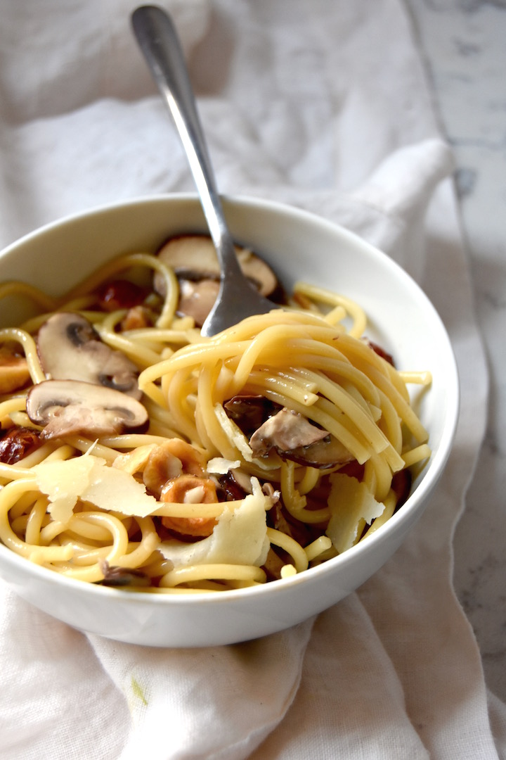 A simple recipe for Spaghetti with Mushrooms, Hazelnuts and Parmesan | uprootkitchen.com
